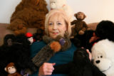 Surround by some of her stuffed gorillas and monkeys, animal rights activist Rita Anderson, cq, is...