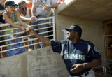 030405 Batting coach Don Baylor hands a signed  baseball to Courtney Kiteley, (cq) 8, of Renton,...