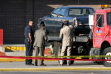 Aurora Police apply evidence seals to a vehicle as they investigate a shooting Thursday May, 18,...