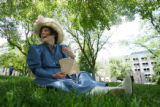 Historical Society Volunteer Debra Faulkner (cq), of Thornton, sits in the shade and fans herself...