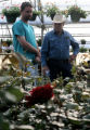 Jim Dill (cq), right, talks about roses and his view on life with Mark Scheckenbach (cq), owner of...