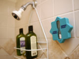 KAS028 An hourglass hangs in the shower in Susi Moser's (cq) Boulder apartment on Wednesday, June...