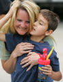 Teddi Gray, CQ, 45, hugs her nephew Evan Thompson, CQ, 8, in front of their Lakewood home the day...
