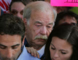 Bob Schindler father of Terri Schiavo listens as his son Bobby speaks to the media accompanied by...