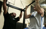 Strength coach Steve Hess, left , works with Louis Amundson, a Monarch High School grad and UNLV...