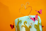 Love grows with this delightful summer garden cake! Fuchsia Butterflies with Crystal tipped wings...