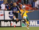The Colorado Rapids Clint Mathis (left) and the Los Angeles Galaxy's Kyle Martino battle for...