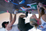 Emily Harrington (cq), 19, of Boulder looks for her next hand hold during bouldering practice at...