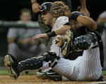Colorado Rockies catcher Yorvit Torrealba, right, makes a play at the plate, successfully tagging...