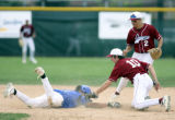 Broomfield's #7, Tyler Lontine, loses his helmet and gets tagged out at second base late in the...