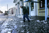 (Kiowa, Co} shot on 3/31/05})  A large deep puddle is no problem for John Carrington Smith (cq)...