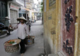 (NYT71) HANOI, Vietnam -- June 14, 2006 -- VIETNAM-LANGUAGE -- On Sunday, June 11, 2006, a street...