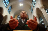 (DENVER, CO., MARCH 31, 2005) Rolando Luna (CQ. Rolando Luna), of Lakewood prays for the well...