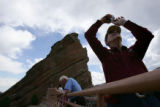 Arthur Perkins (cq), right, of Las Cruces, NM., takes a picture of the rock formations during a...