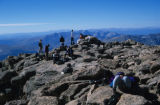 The crowded summit of Longs Peak (elevation 14,259 feet) on a beautiful August day. Ironically for...