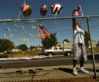Madras residents create a memorial fence at the Westside Elementary School to mourn the loss of...
