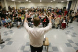 Denver Public Schools Superintendent Michael Bennet answers questions from a crowd of over two...