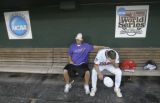 CWS115 - Clemson coach Jack Leggett, right, and Tanner Legget sit in the dugout after losing 7-6...