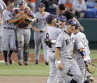 CWS113 - Cal State Fullerton players Brett Pill (9), Joe Turgeon (1), Justin Turner, right, and...