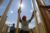 Greco Gomez (cq) works on a new condominium near Loveland, Colo., on Monday, June 20, 2006. ...