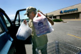 Dan Levin (cq), 77, of Lakewood, loads groceries into his truck outside Albertson's in Lakewood,...