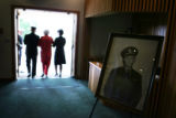 A photo of Ensign Robert Keller, killed in WWII in 1942, stands in a funeral home chapel as his...