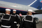 A Naval honor guard removes the casket of Ensign Robert Keller, who was killed in WWII, from a jet...