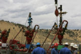 JPM990 A work crew gathers at ExxonMobile's natural gas wells on the Love Ranch #6 pad at...
