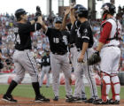 CSB104 - Chicago White Sox' Joe Crede (24) is congratulated by Tadahito Iguchi (15), Jermaine Dye,...