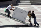Workers from Richter Scale Productions (cq) unload sound equipment at Civic Center Park  in...