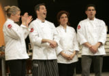 The four chefs competing in the Thanksgiving Food Network Challenge react as Joey Campanaro (far...