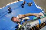 Chad Gilbert (cq), 26, of Newport Beach, Ca. reaches for the final hand hold on a route during...