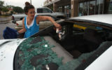 (Denver, Colo., June 9, 2004) Missy McLaughlin, of Littleton, removes her car mascot from the back...