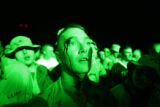 03/30/2005 Camp Buehring, Kuwait-A soldier bleeds from the forehead after moshing to rock group...