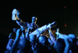 "03/30/2005 Camp Buehring, Kuwait-Soldiers crowd surf to the rock group ""Adema"" as they..."