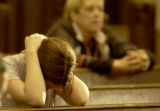 Denver, Colo., photo taken April 1, 2005- Tina Rice (cq left), 23, of Denver, Colo., prays with...