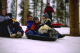Families enjoy a day of tubing at YMCA's  Snow Mountain Ranch lighted tubing hill, complete with...