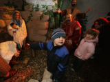 Tanner Custer, 3 points to the nativity scene with sister Kendall Custer 4 and mom, Deanna Custer...