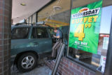 An SUV sits halfway into the front window of the Souper Salad at 8936 W. Bowles in Littleton,...