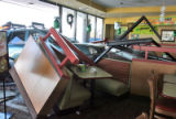 An SUV sits halfway into the front window of the Souper Salad at 8936 W. Bowles in Littleton...