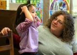 Isabelle May  (cq) with teacher Becky Sheinbaum (cq) at the Jewish Community Center's child...