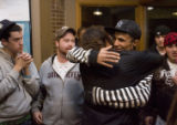 DM0016   Dan Griebenow, stripes, gets a hug as members of Youth With A Mission welcome him home...
