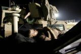 04/03/2005 Iraq-SPC David Campbell, 23, Latrobe, Penn.,  sleeps on the hood of his Humvee at...