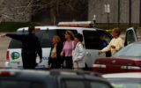 (NORTHGLENN, Colo., Apr. 4, 2005) Northglenn Police officer directs people from the Wells Fargo...