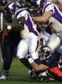 DM0098   Denver Broncos safety John Lynch drags running back Chester Taylor down from behind in...