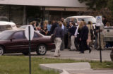 (NORTHGLENN shot on 4/4/05) People who were being escorted out of the Wells Fargo bank building on...