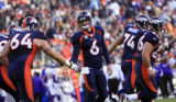 DM1369   Denver Broncos quarterback Jay Cutler is congratulated by his teammates after completing...