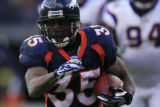 DM1277   Denver Broncos running back Selvin Young scrambles to the outside in the second quarter...