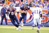 DM1209   Denver Broncos tight end Tony Scheffler scrambles for extra yards after pulling in a pass...