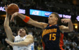 The Denver Nuggets Eduardo Najera, has the ball knocked away by Golden State Warriors Andris...